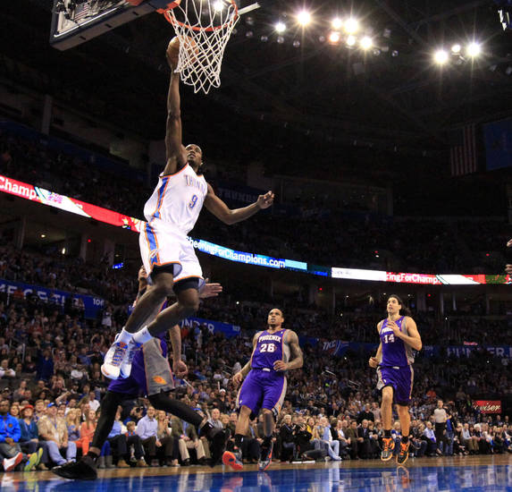 Oklahoma City's' Serge Ibaka (9) dunks the ball during the NBA game between the Oklahoma City Thunder and the Phoenix Suns at theChesapeake Energy Arena, Saturday, Feb. 9, 2013.Photo by Sarah Phipps, The Oklahoman