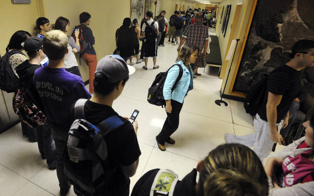 Colorado State students form a line down the hall to vote on campus during Election Day, Tuesday Nov. 6, 2012, in Fort Collins, Colo. (AP Photo/The Coloradoan, V. Richard Haro) NO SALES