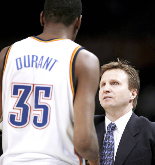 Thunder coach Scott Brooks talks to Kevin Durant during a timeout against San Antonio on Tuesday at the Ford Center. Photo by Sarah Phipps, The Oklahoman