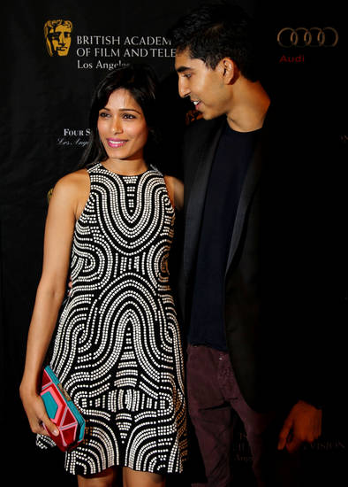Actors Dev Patel, right, and Freida Pinto arrive at the BAFTA Awards Season Tea Party at The Four Seasons Hotel on Saturday, Jan. 12, 2013, in Los Angeles. (Photo by Matt Sayles/Invision/AP)