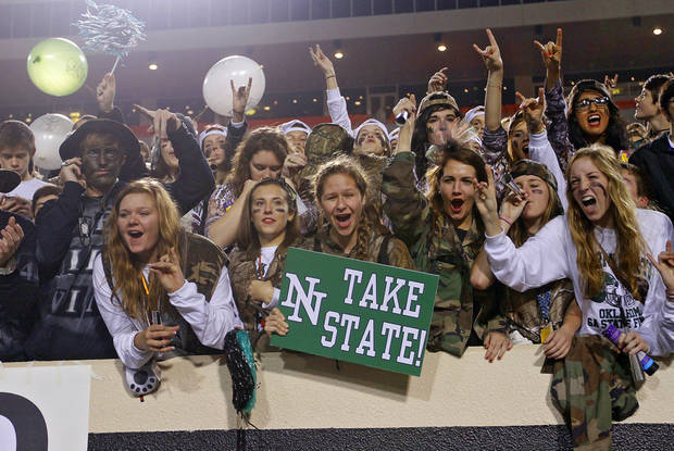 Norman North fans have fun in the stands during the Class 6A Oklahoma state championship football game between Norman North High School and Jenks High School at Boone Pickens Stadium on Friday, Nov. 30, 2012, in Stillwater, Okla.   Photo by Chris Landsberger, The Oklahoman