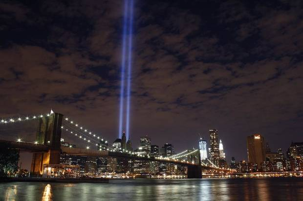The Tribute in Light rises over the Brooklyn Bridge and lower Manhattan, Saturday, Sept. 10, 2011 in New York. Sunday will be the 10th anniversary of the attacks on the United States. (AP Photo/Peter Lennihan)