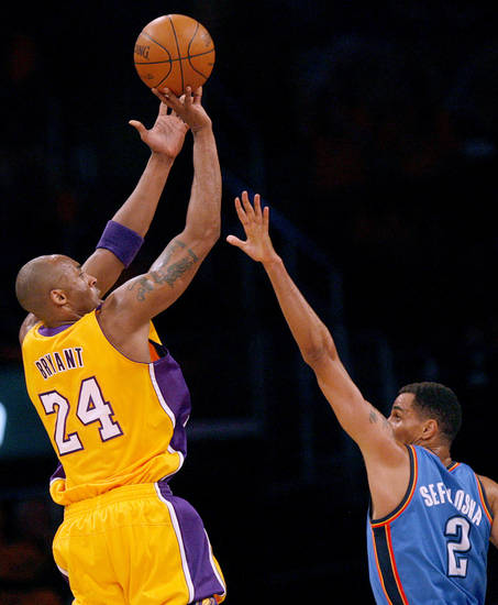Thabo Sefolosha (2) defends against Los Angeles' Kobe Bryant (24) during Game 3 in the second round of the NBA basketball playoffs between the L.A. Lakers and the Oklahoma City Thunder at the Staples Center in Los Angeles, Friday, May 18, 2012. Photo by Nate Billings, The Oklahoman