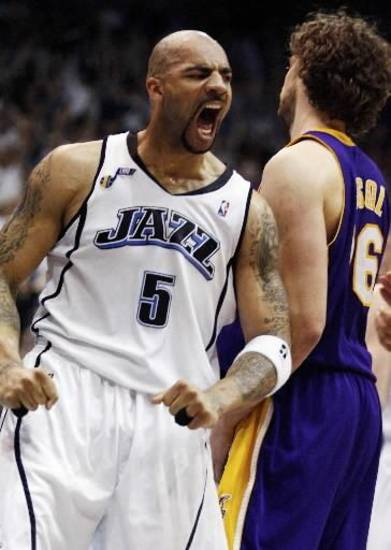 Utah Jazz forward  Carlos  Boozer (5) shouts in celebration as the buzzer sounds at the end of Game 3 of their NBA basketball first-round playoff series against the Los Angeles Lakers on Thursday, April 23, 2009 in Salt Lake City. The Jazz beat the Lakers 88-86. (AP Photo/Steve C. Wilson)