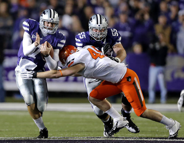 Oklahoma State&#039;s Caleb Lavey (45) tries to stop Kansas State&#039;s Collin Klein (7) during the college football game between the Oklahoma State University Cowboys (OSU) and the Kansas State University Wildcats (KSU) at Bill Snyder Family Football Stadium on Saturday, Nov. 1, 2012, in Manhattan, Kan. Photo by Chris Landsberger, The Oklahoman