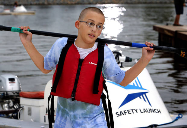 Xavier McIntyre, 11, Yukon, Okla. carries his paddle at the 2012 Oklahoma Regatta Festival on Friday, Sept. 28, 2012 in Oklahoma City, Okla.  Photo by Steve Sisney, The Oklahoman