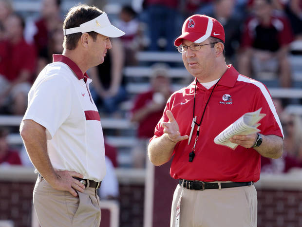 Oklahoma Sooners head coach Bob Stoops and Ball State Cardinals head coach Pete Lembo talk before the college football game between the University of Oklahoma Sooners (OU) and the Ball State Cardinals at Gaylord Family-Oklahoma Memorial Stadium on Saturday, Oct. 1, 2011, in Norman, Okla. Photo by Steve Sisney, The Oklahoman