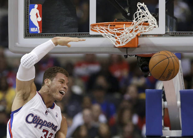 Los Angeles Clippers forward Blake Griffin celebrates a dunk against the Utah Jazz during the first half of an NBA basketball game in Los Angeles, Saturday, Feb. 23, 2013. (AP Photo/Chris Carlson)