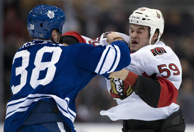 Toronto Maple Leafs left winger Fraser McLaren (38) knocks out Ottawa Senators left winger Dave Dziurzynski during a fight in first-period NHL hockey game action in Toronto, Wednesday, March 6, 2013. (AP Photo/The Canadian Press, Frank Gunn)