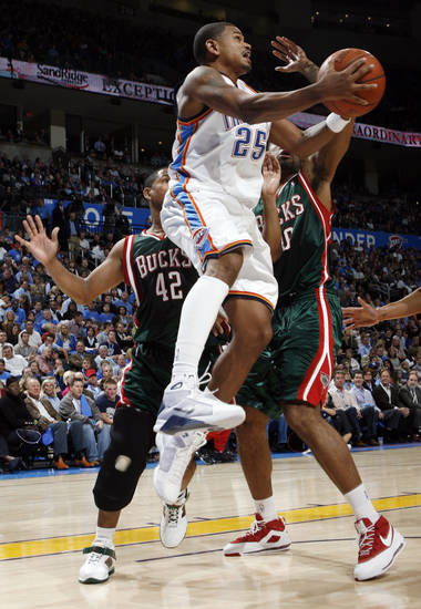 Earl Watson (25) of the Thunder passes the ball during the NBA basketball game between the Oklahoma City Thunder and the Milwaukee Bucks at the Ford Center in Oklahoma City, Wednesday, Oct. 29, 2008. This was the regular season debut of the Thunder. BY NATE BILLINGS, THE OKLAHOMAN