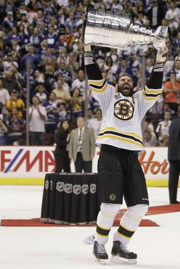 Boston Bruins defenseman Zdeno Chara carries the Stanley Cup after the Bruins beat the Vancouver Canucks 4-0 during Game 7 of the NHL hockey Stanley Cup Finals, Wednesday, June 15, 2011, in Vancouver, British Columbia. (AP Photo/Julie Jacobson) ORG XMIT: JJX122