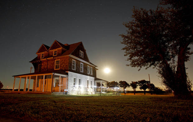 In this long exposure image a crowd gathers around the officers' quarters during a guided ghost tour by lantern light around Fort Reno in El Reno on Saturday, Sept. 21, 2013. Photo by Bryan Terry, The Oklahoman