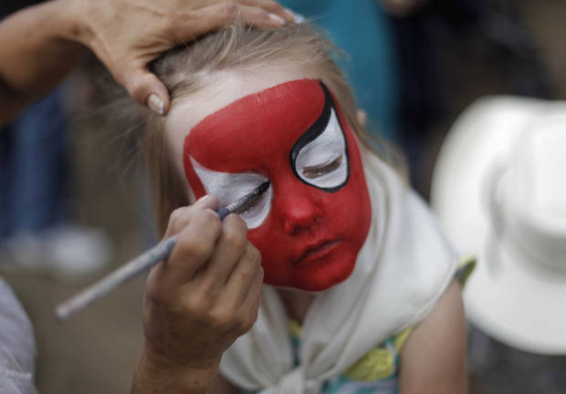 Addison Harrison, 4, of Soper, Okla., gets her face painted as Spiderman at the Oklahoma State Fair, Sunday, Sept. 23, 2012.  Photo by Garett Fisbeck, The Oklahoman