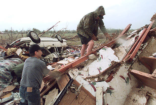 MAY 3, 1999 TORNADO: TORNADO VICTIMS, DAMAGE: L TO R. BILL PAIGE AND JACK JONES GO THREW A HOUSE LOOKING FOR ANYTHING SALVAGEABLE AFTER A TORNADO FLATTENS A HOUSE OFF OF 12TH STREET AND SANTA FE IN MOORE, OK.