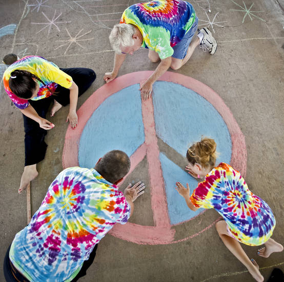 A crew of artists work on a peace sign during the sidewalk chalk contest in Downtown Edmond on Friday, June 29, 2012, in Edmond, Oklahoma. Photo by Chris Landsberger, The Oklahoman