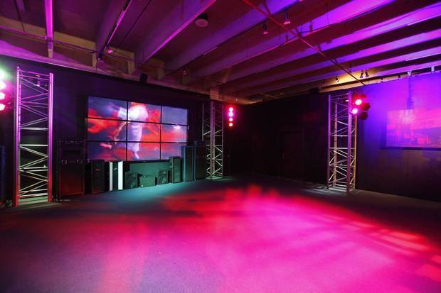 "A rock concert video room with a 20-foot video wall, light show and crowd effects is part of ""The Science of Rock 'n' Roll"" exhibit at Science Museum Oklahoma. Photo by Paul Hellstern, The Oklahoman"