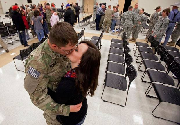 Spc Adam Nicely, Wagoner, is greeted by his girlfriend Shae Bellis, 20, as members of the Oklahoma National Guard are welcomed by family and friends on their return from Afghanistan on Thursday, Jan. 12, 2012, in Norman, Okla.   Photo by Steve Sisney, The Oklahoman