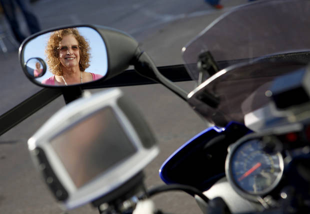 Denise Dickenson poses for a photo by her Yamaha FZ1 at Maxey's Cycles in Oklahoma CIty, Saturday, March 24, 2012. Maxey's Cycles hosted a party in honor of Denise Dickenson after she recently passed the 200,000 mile mark on her Yamaha FZ1. Photo by Bryan Terry, The Oklahoman