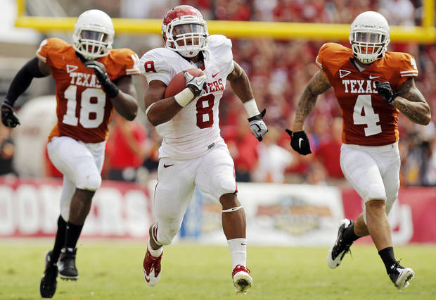 OU's Dominique Whaley (8) breaks away from UT's Emmanuel Acho (18) and Kenny Vaccaro (4) on a touchdown run in the second half during the Red River Rivalry college football game between the University of Oklahoma Sooners (OU) and the University of Texas Longhorns (UT) at the Cotton Bowl in Dallas, Friday, Oct. 7, 2011. OU won, 55-17. Photo by Nate Billings, The Oklahoman