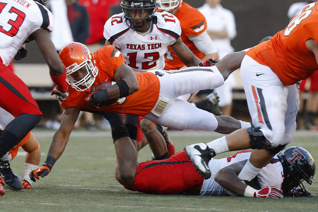 Oklahoma State's Joseph Randle (1) leaps for more yards during a college football game between Oklahoma State University (OSU) and Texas Tech University (TTU) at Boone Pickens Stadium in Stillwater, Okla., Saturday, Nov. 17, 2012.  Photo by Bryan Terry, The Oklahoman