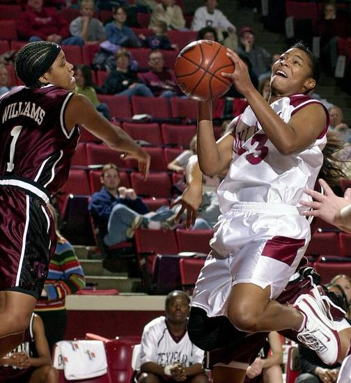 WOMEN'S COLLEGE BASKETBALL: Oklahoma (OU) Sooner #33 Rosalind Ross goes up for a shot against Texas #1 Toccara Williams of Texas A&M in Wed. nights game at the Lloyd Noble Center in Norman. Staff Photo by Ty Russell.
