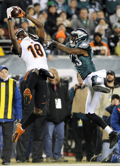 Cincinnati Bengals' A.J. Green, left, hangs onto a pass as Philadelphia Eagles' Dominique Rodgers-Cromartie defends in the second half of an NFL football game on Thursday, Dec. 13, 2012, in Philadelphia. (AP Photo/Michael Perez)