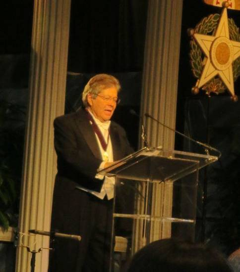 Dr. Ron White accepts his award. He was presented by Glen Johnson. (Photo by Helen Ford Wallace).