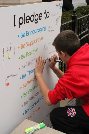 A student signs the Be Kind Pledge to be encouraging, supportive, positive, helpful, honest, considerate, thankful, responsible, respectful and a friend. Photo provided <strong></strong>