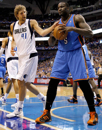 Dirk Nowitzki (41) of Dallas  tries to knock the ball away from Oklahoma City's Kendrick Perkins (5) after a foul during game 5 of the Western Conference Finals in the NBA basketball playoffs between the Dallas Mavericks and the Oklahoma City Thunder at American Airlines Center in Dallas, Wednesday, May 25, 2011. Photo by Bryan Terry, The Oklahoman
