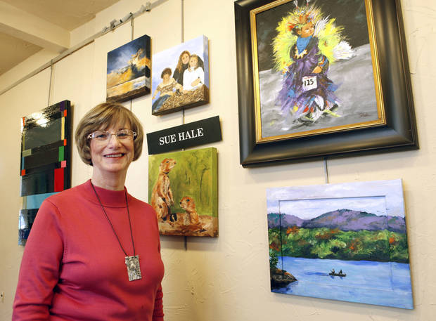 Sue Hale, who's paintings will be featured in a new exhibit to raise funds for EduCare, shows some of her work at her studio in the Paseo district in Oklahoma City, OK, Monday, October 29, 2012,  By Paul Hellstern, The Oklahoman