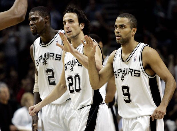 Above: From left, Spurs players Nazr Mohammed, Manu Ginobili, and Tony Parker celebrate during a 2005 Western Conference Semifinal game against the Sonics. AP photo