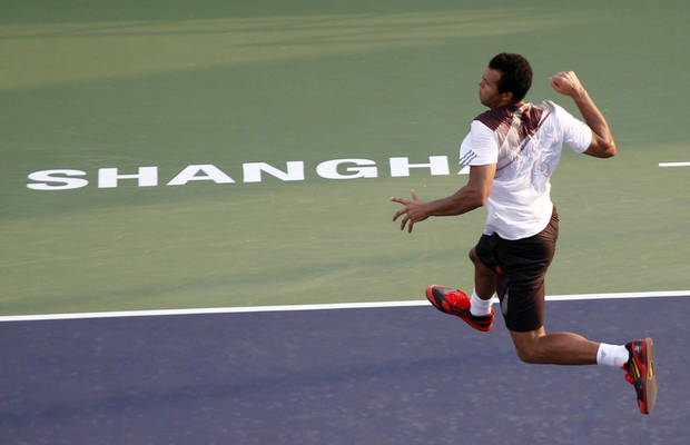 France's Jo-Wilfried Tsonga celebrates after defeating Japan's Kei Nishikori during the mens singles match of the Shanghai Masters tennis tournament at the Qizhong Forest Sports City Tennis Center in Shanghai, China, Thursday Oct 10, 2013. Tsonga won 7-6, 6-0.  (AP Photo)
