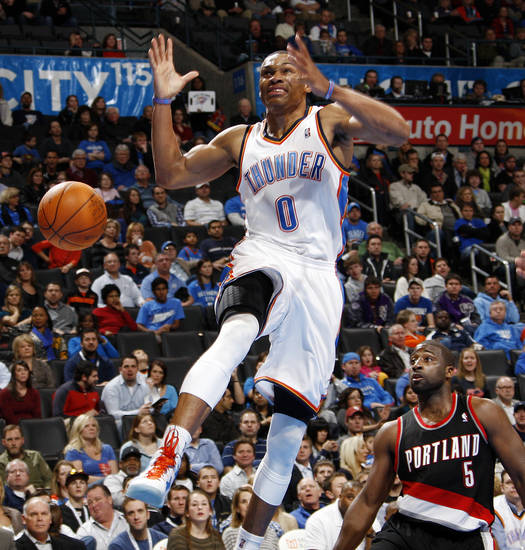 Oklahoma City's Russell Westbrook (0) loses control of the ball in front of Raymond Felton (5) of Portland in the fourth quarter of the NBA basketball game between the Oklahoma City Thunder and Portland Trail Blazers at Chesapeake Energy Arena in Oklahoma City, Tuesday, Jan. 3, 2012. Portland won, 103-93. Photo by Nate Billings, The Oklahoman
