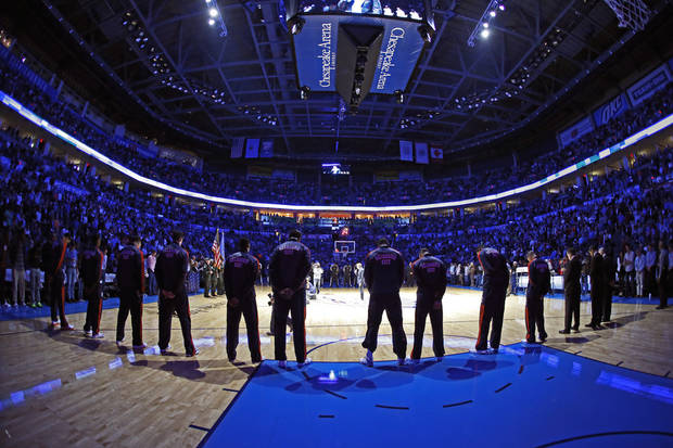 The crowd prays before an NBA basketball game between the Oklahoma City Thunder and the Sacramento Kings at Chesapeake Energy Arena in Oklahoma City, Friday, Dec. 14, 2012. Photo by Bryan Terry, The Oklahoman