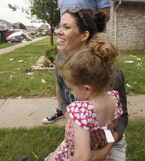 Briarwood Elementary School 5th grade teacher Robin Dziedzic hugs a small child who dropped by to offer her water while she talks about her experiences when her school was destroyed by the May 20th tornado in Moore, OK, Saturday, May 25, 2013,  Photo by Paul Hellstern, The Oklahoman
