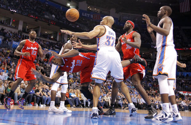 Oklahoma City's Derek Fisher (37) defends on Los Angeles Clippers point guard Eric Bledsoe (12) during the NBA basketball game between the Oklahoma City Thunder and the Los Angeles Clippers at Chesapeake Energy Arena on Wednesday, March 21, 2012 in Oklahoma City, Okla.  Photo by Chris Landsberger, The Oklahoman