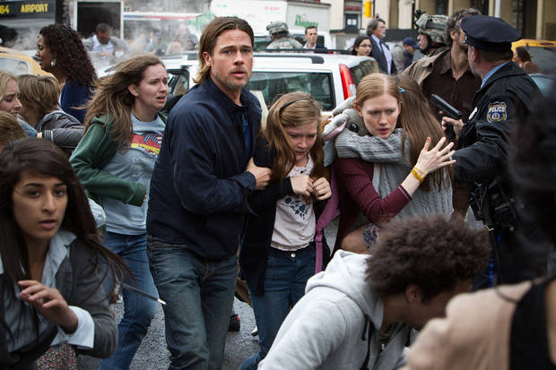 "This publicity image released by Paramount Pictures shows, from center left, Brad Pitt as Gerry Lane, Abigail Hargrove as Rachel Lane, and Mireille Enos as Karin Lanein a scene from ""World War Z."" (AP Photo/Paramount Pictures, Jaap Buitendijk) ORG XMIT: NYET228"