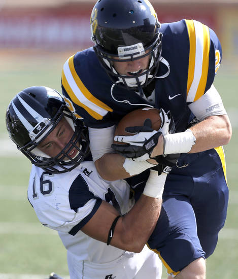 Washburn's Calvin Kenney tackles UCO's Christian Hood during the college football game between the University of Central Oklahoma and Washburn at Wantland Stadium in Edmond, Okla., Saturday, Sept. 22, 2012.  Photo by Sarah Phipps, The Oklahoman