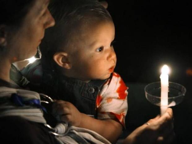 File photo of a 2006 candlelight vigil on  child  abuse in Norman by Steve Sisney