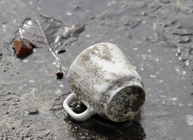 A cup lies at the bottom of the  Bricktown Canal after it was drained for cleaning in Oklahoma City, January 18, 2012.   Photo By Steve Gooch, The Oklahoman