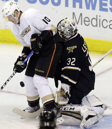 Dallas Stars goalie Kari Lehtonen (32) defends the goal against Anaheim Ducks right wing Corey Perry (10) during the first period of an NHL hockey game on Friday, Feb. 8, 2013, in Dallas. (AP Photo/LM Otero)