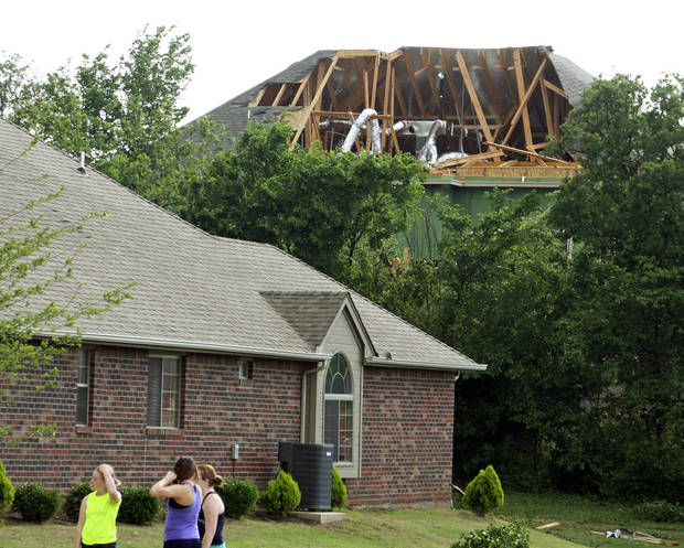 People look at damage to homes in the Thornbrook neighborhood after a tornado moved through Edmond, Okla., Sunday, May 19, 2013. Photo by Dave Fisk, for The Oklahoman