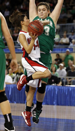 Sulphur's Ilie Saunders shoots guarded by Anna Crawford during the 3A girls semifinal game between the Adair High School Lady Warriors and the Sulphur Lady Bulldogs at the State Fair Arena on Friday, March 8, 2013 in Oklahoma City, Okla.  Photo by Steve Sisney, The Oklahoman