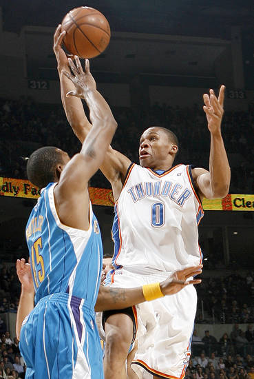 Oklahoma City's Russell Westbrook shoots over Rasual Butler of the Hornets during the NBA basketball game between the New Orleans Hornets and the Oklahoma City Thunder at the Ford Center,Tuesday, Feb. 17, 2009. PHOTO BY BRYAN TERRY, THE OKLAHOMAN ORG XMIT: KOD