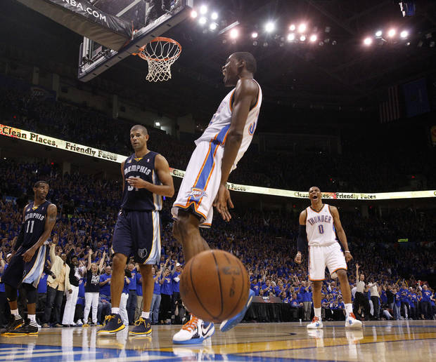 Oklahoma City's Kevin Durant (35) and Russell Westbrook (0) react after a dunks near Mike Conley (11) and Shane Battier (31) of Memphis in the fourth quarter during game 7 of the NBA basketball Western Conference semifinals between the Memphis Grizzlies and the Oklahoma City Thunder at the OKC Arena in Oklahoma City, Sunday, May 15, 2011. Photo by Sarah Phipps, The Oklahoman