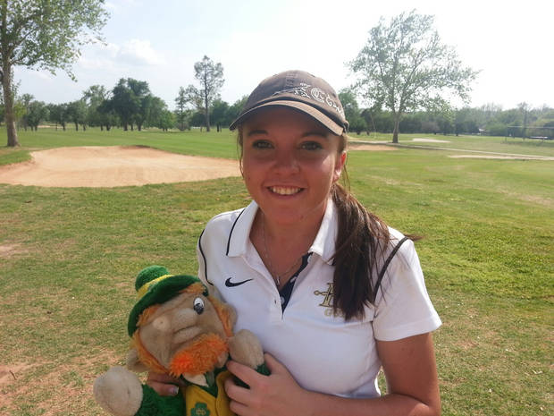 CLASS 3A GIRLS HIGH SCHOOL GOLF / STATE TOURNAMENT: Morgan Brown, Henryetta girls golfer, and her Fighting Irish head cover. Photo by Ed Godfrey, The Oklahoman KOD