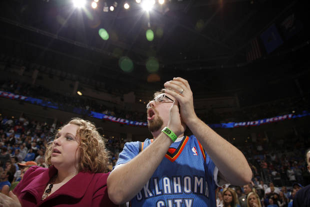 Oklahoma City Fans Jamie and Brad Thomas of Ponca City, Okla., cheer on the Thunder during the NBA game between the Oklahoma City Thunder and the Miami Heat Sunday Jan. 18, 2009, at the Ford Center in Oklahoma City. PHOTO BY SARAH PHIPPS, THE OKLAHOMAN