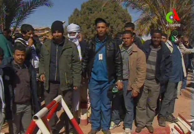Unidentified rescued hostages pose for the media in Ain Amenas, Algeria, in this image taken from television  Friday Jan. 18, 2013. Algeria�s state news service says nearly 100 out of 132 foreign hostages have been freed from a gas plant where Islamist militants had held them captive for three days.  The APS news agency report was an unexpected indication of both more hostages than had previously been reported and a potentially breakthrough development in what has been a bloody siege. (AP Photo/Canal Algerie  via Associated Press TV)  **  TV OUT   ALGERIA OUT  **