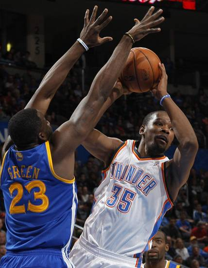 Oklahoma City 's Kevin Durant (35) goes against Golden State's Draymond Green (23) during an NBA basketball game between the Oklahoma City Thunder and the Golden State Warriors at Chesapeake Energy Arena in Oklahoma City, Sunday, Nov. 18, 2012.  Photo by Garett Fisbeck, The Oklahoman