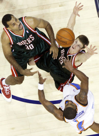Desmond Mason (34) of the Thunder tries to get a shot off over the Bucks' Malik Allen (30) and Luke Ridnour (13) during the first half of the opening night NBA basketball game between the Oklahoma City Thunder and the Milwaukee Bucks on Wednesday, Oct. 29, 2008, at the Ford Center in Oklahoma City, Okla.